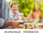 close up on hands holding a... | Shutterstock . vector #553006141
