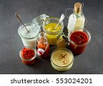 Various sandwich condiments in...