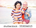 playful couple with woman burst ... | Shutterstock . vector #553036015