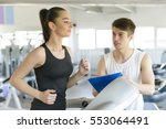 woman running on treadmill at... | Shutterstock . vector #553064491