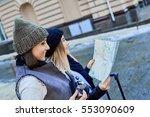 two friends tourists choose... | Shutterstock . vector #553090609