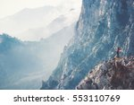 woman traveler on cliff hiking... | Shutterstock . vector #553110769
