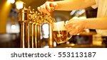 gold beer in the hand and beer... | Shutterstock . vector #553113187