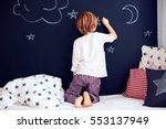 cute kid in pajamas painting... | Shutterstock . vector #553137949