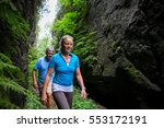Older Couple Hiking In The...