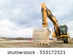 Small photo of Excavator is Preparing a Construction Site