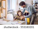 attentive father giving a glass ... | Shutterstock . vector #553183201