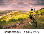 Cyclist Admires From The Hill...