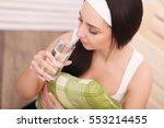 studio shot of a young woman... | Shutterstock . vector #553214455