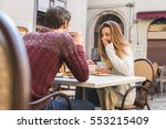 young couple talking at coffee... | Shutterstock . vector #553215409