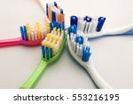 colorful toothbrushes on white...   Shutterstock . vector #553216195