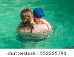 beautiful young mother with son ... | Shutterstock . vector #553235791