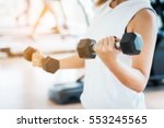 Blurred woman lifting dumbbells ...