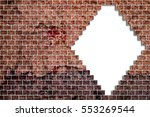 hole in a old brick wall... | Shutterstock . vector #553269544
