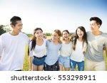 Happy Young Asian Group Walkin...