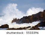 Wild Surf Hitting Rocks On The...