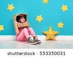 child girl in an astronaut... | Shutterstock . vector #553350031