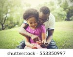 african american family playing ... | Shutterstock . vector #553350997