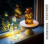 christmas lights in glass jars... | Shutterstock . vector #553370455