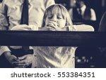 little girl praying church... | Shutterstock . vector #553384351