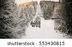 people are lifting on ski lift... | Shutterstock . vector #553430815