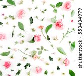Stock photo floral pattern made of pink and beige roses green leaves branches on white background flat lay 553434979