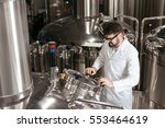 satisfied man using brewing... | Shutterstock . vector #553464619