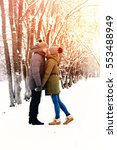 couple in love outdoor winter | Shutterstock . vector #553488949