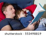 father reading a story to his...   Shutterstock . vector #553498819