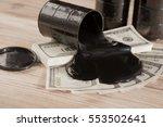 oil barrels and poured money... | Shutterstock . vector #553502641