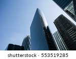 skyscrapers with glass facade.... | Shutterstock . vector #553519285