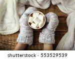 woman holding cup of hot cocoa... | Shutterstock . vector #553529539