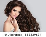 healthy curly hair. beautiful... | Shutterstock . vector #553539634