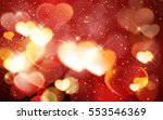 golden glowing hearts on a red... | Shutterstock .eps vector #553546369