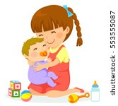 little girl hugging a baby | Shutterstock .eps vector #553555087