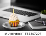 tasty cupcake on working place | Shutterstock . vector #553567207