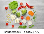 fresh vegetables on wooden... | Shutterstock . vector #553576777