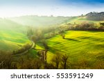 green hills at sunset in italy. | Shutterstock . vector #553591249
