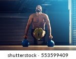 young fitness man is training... | Shutterstock . vector #553599409