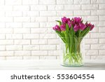 Glass vase with bouquet of...