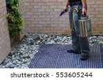 The Exterminator,Technicians compressed chemicals into the soil around the area. To break the cycle termite queens. Selective focus. - stock photo