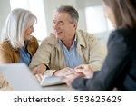 senior couple meeting financial ... | Shutterstock . vector #553625629