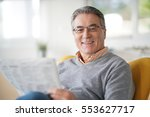 smiling senior man with... | Shutterstock . vector #553627717