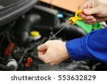 mechanic repairing car with... | Shutterstock . vector #553632829