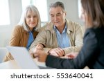 senior couple meeting financial ... | Shutterstock . vector #553640041