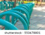 bike rack in parking lot | Shutterstock . vector #553678801