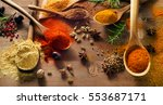 various spices on wooden board. ... | Shutterstock . vector #553687171