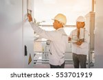 two engineer working on... | Shutterstock . vector #553701919