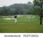 Man Golf Player With Driver...