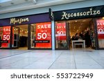 Small photo of Basingstoke, UK - January 04 2017: Shop fronts of Monsoon and Accessorize fashion stores with 50% off Sale signs